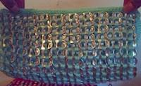 http://mundo-manualidades.com/bolso-o-monedero-hecho-con-anillas-de-latas-en-crochet.html