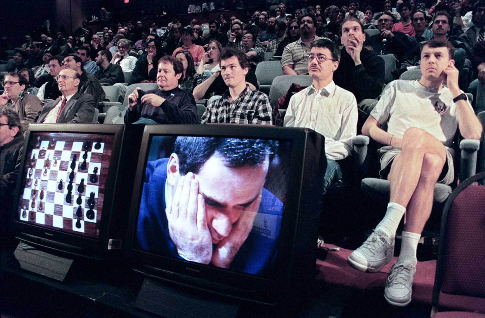 Spectators watch a live broadcast of Game 3.
