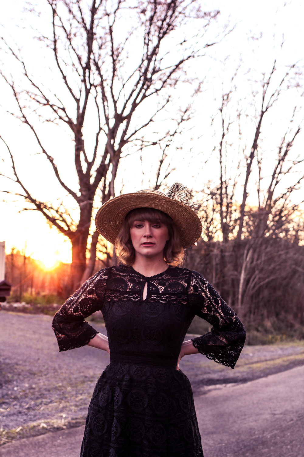 Liana of @findingfemme in black lace dress and winter boater