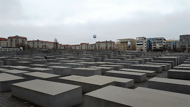 concrete slabs arranged in a grid pattern on a sloping field