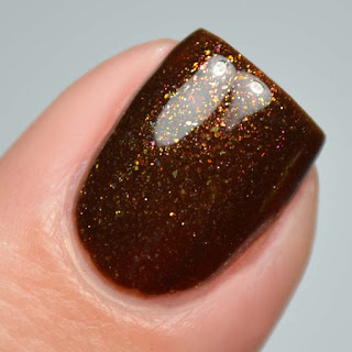 black jelly polish with metallic shimmer