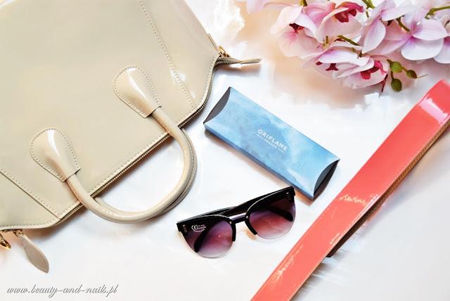 Akcesoria Oriflame: torebka, zegarek i okulary.
