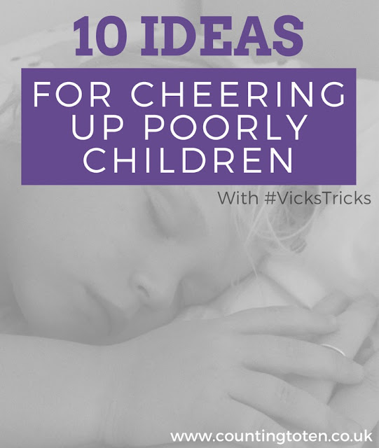 A black and white image of a sleeping child holding a parents hand with title text in front of it (10 ideas for cheering up poorly children with #VicksTricks