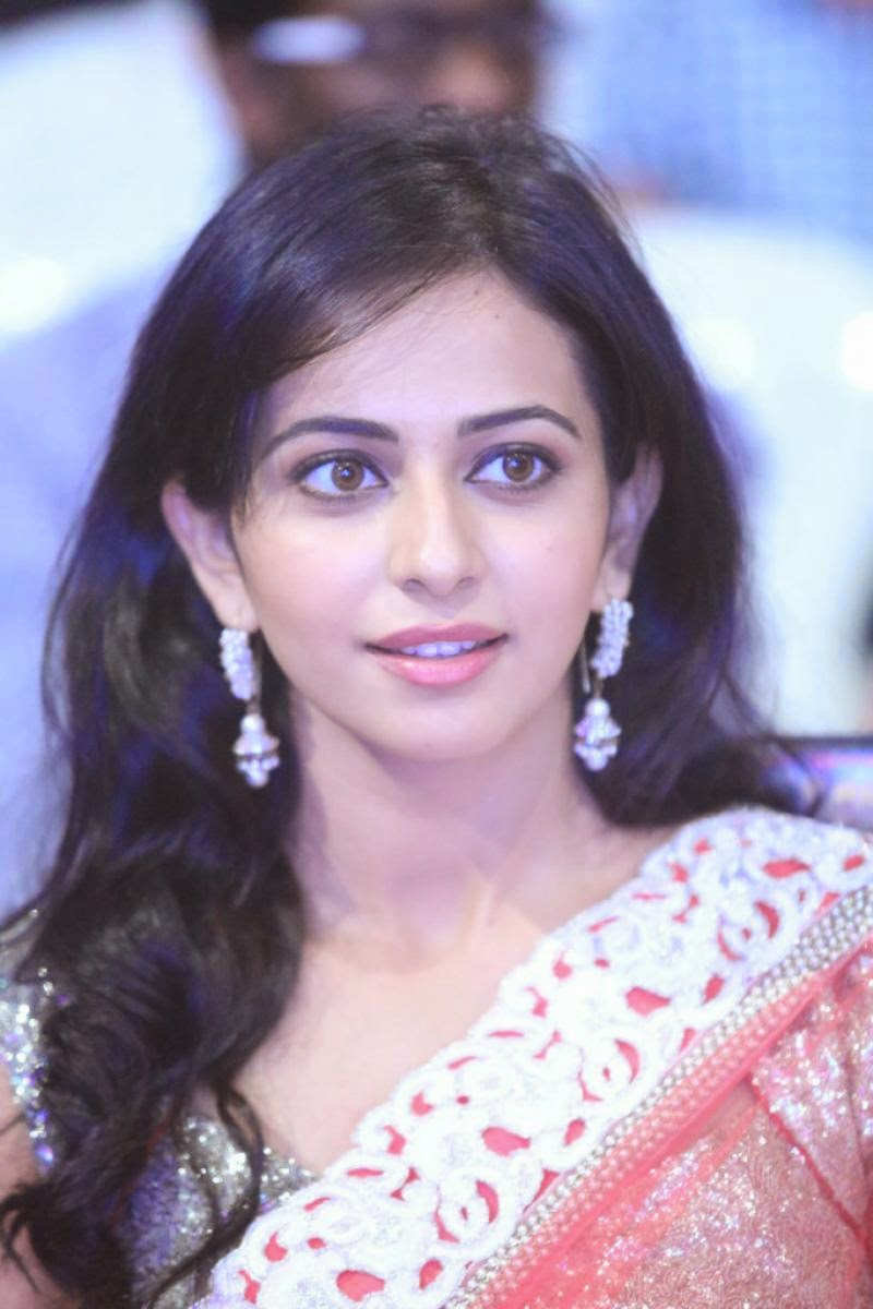 Cute Smiling Face Close Up Stills Of Rakul Preet Singh In Red Saree