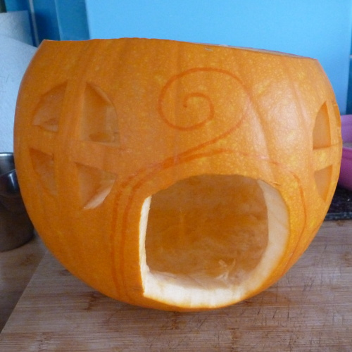 Drawing detail on the pumpkin for carving