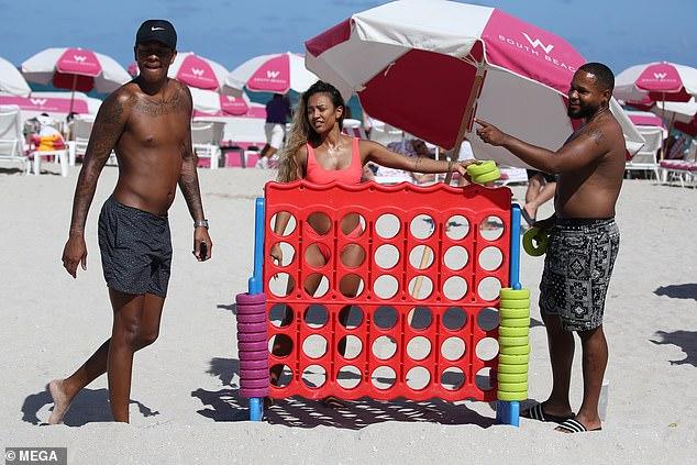 Karrueche Tran looks phenomenal in a pink barely-there thong bikini on Miami beach