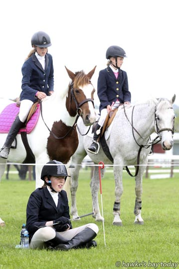 Front: Emma Dunderdale, Waipawa;  Back L-R: Lucy Buchanan, Havelock North, Makayla White, Patoka - waiting for their turn in the showjumping ring at the Hawke's Bay Show, Royal A and P Show of New Zealand at the Hawke's Bay Showgrounds, Hastings. photograph
