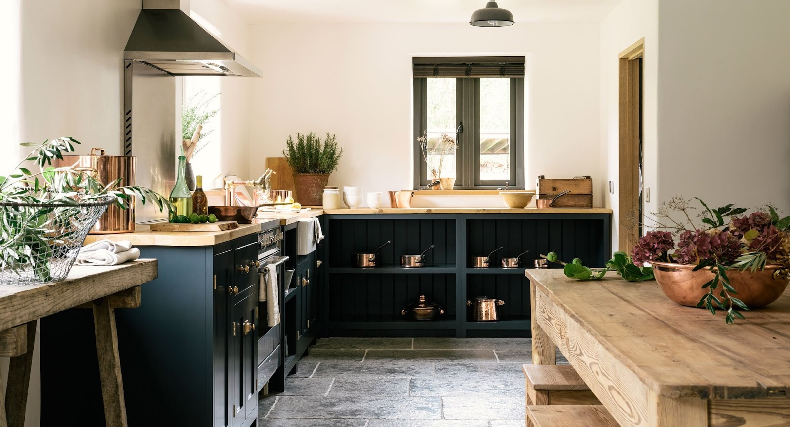 Gorgeous modern country kitchen with dark blue cabinets  found on Hello Lovely Studio Handsome Custom Country Kitchen a Budget