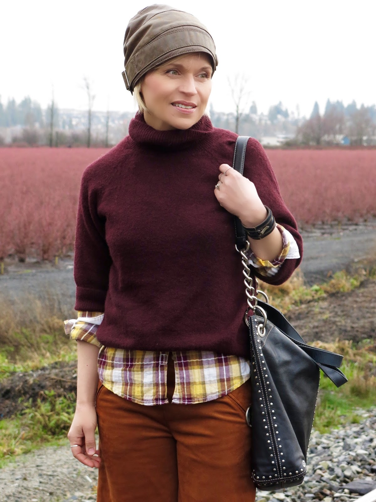maroon wool turtleneck, plaid shirt, MIchael Kors bag, and leather beanie