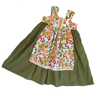http://www.knot-dresses.com/dresses-and-tops/apron-knot-dress-for-girls-olive-floral/