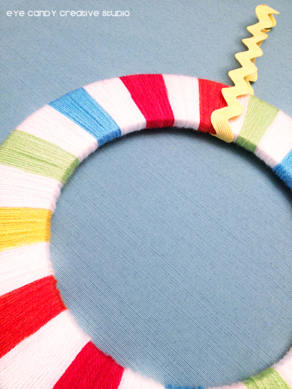 rainbow yarn wrapped wreath, rainbow loom party decor, simple wreath making
