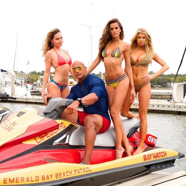 Izabel Goulart, Belinda Peregrín and Charlotte McKinney with The Rock.