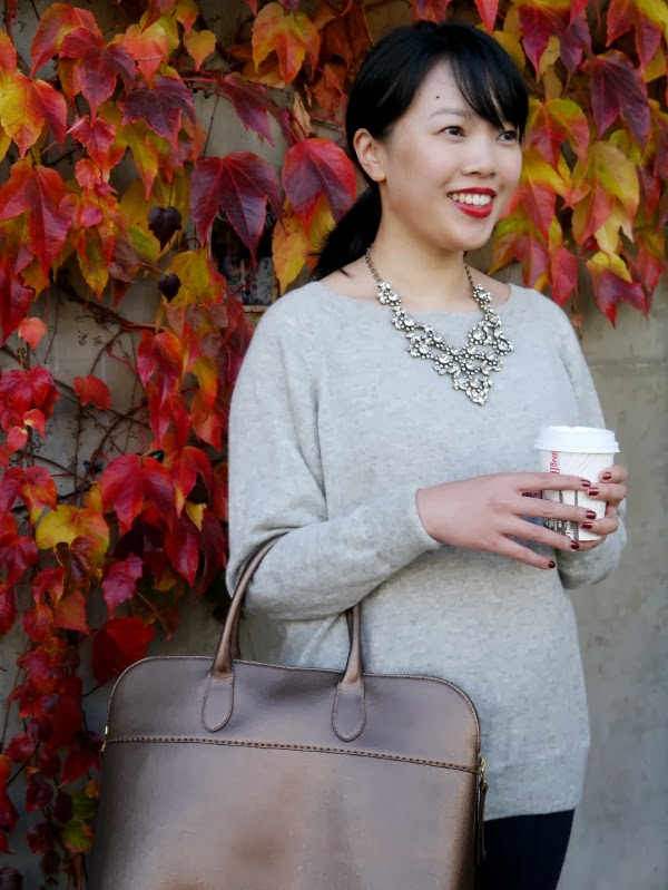 Grey J. Crew cashmere sweater worn with sparkly J. Crew statement necklace, dark wash skinny jeans, a custom gold saffiano leather bag from Roots, and red Dior lipstick.