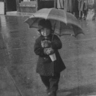 My Mum on Largs seafront after a shower of rain during the 1930s.