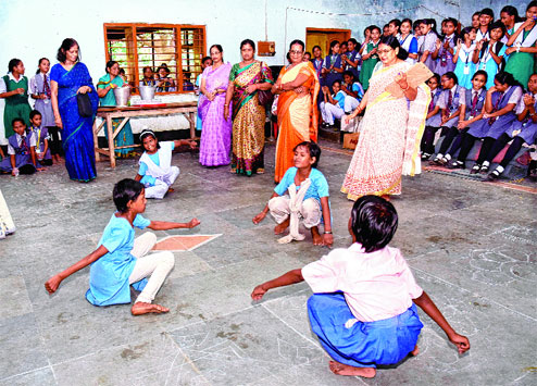 Little girls enjoying a game of 'Puchi khela'