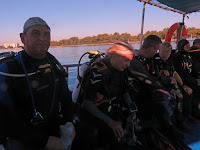 scuba divers diving from a hard boat in Protaras