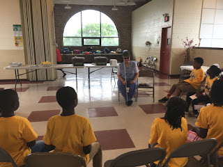Laurel talks to Day campers at East Side Community Center