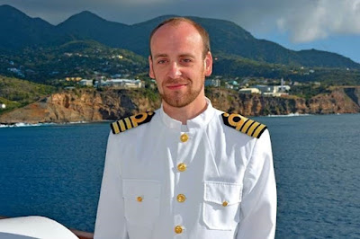 Captain James Griffiths as the captain of Scenic Eclipse
