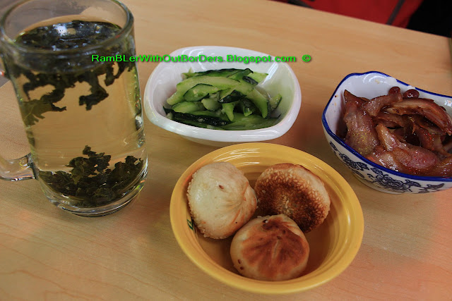 Tie Guanyin tea, pickled cucumber, pig's noses and pan-fried dumpling