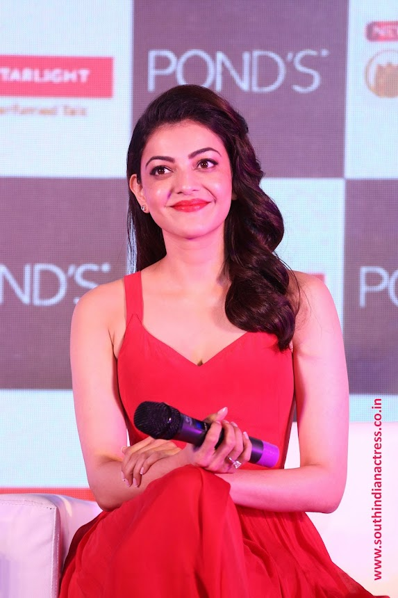 Kajal Aggarwal stunning beauty in red at Ponds Starlight perfumed talc launch