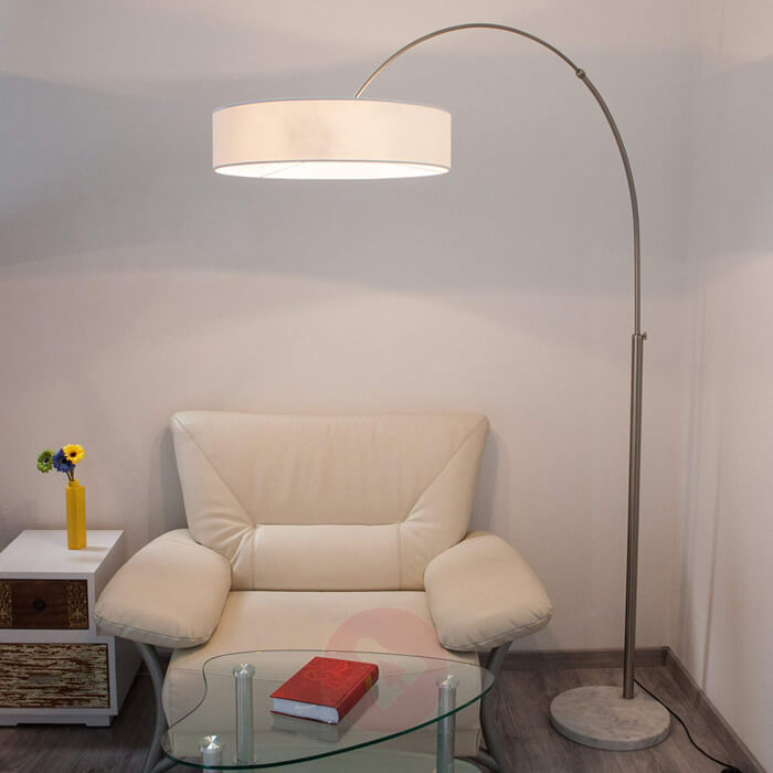 Photo of arc lamp with circular lampshade and circular cement floor lamp