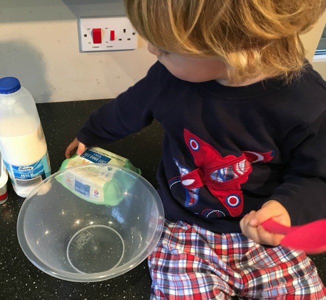 toddler-with-bowl-eggs-and-milk
