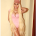 Nicki Minaj wows in pink body suit and knee long blonde hair