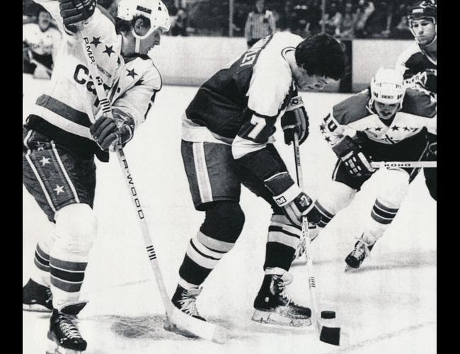 Vs. Minnesota: Glen Sharpley again, as a North Star, with Wes Jarvis and                     Rolf Edberg as bookends (3-3 tie, 12/3/80)