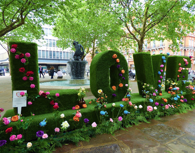 Floral letters in Sloane Square, London, for Chelsea in Bloom 2018 free flower festival