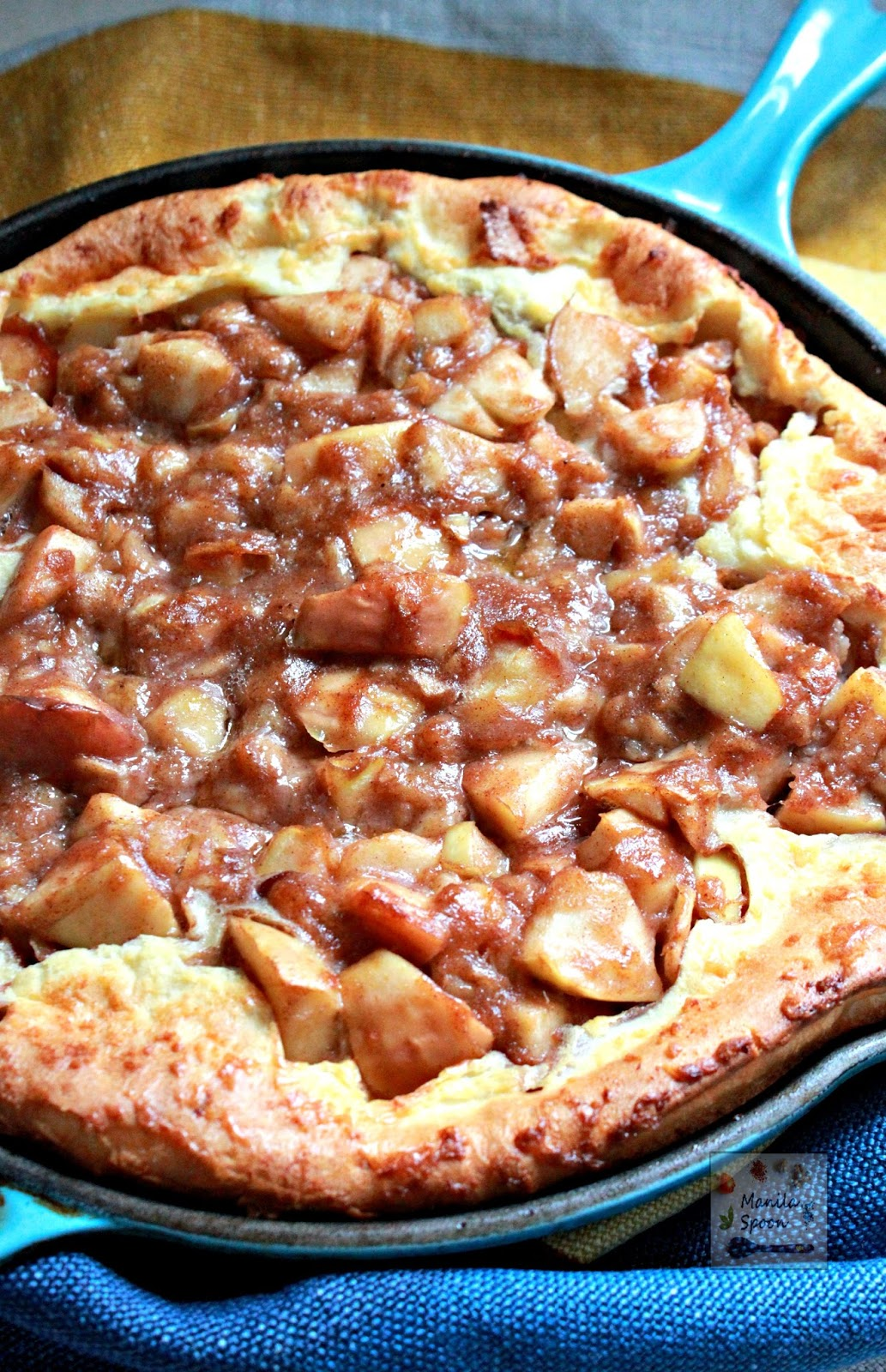 Delicious and easy to make Dutch Baby Pancake loaded with cinnamon spiced Apples and Bananas! So yummy and perfect for breakfast or brunch!
