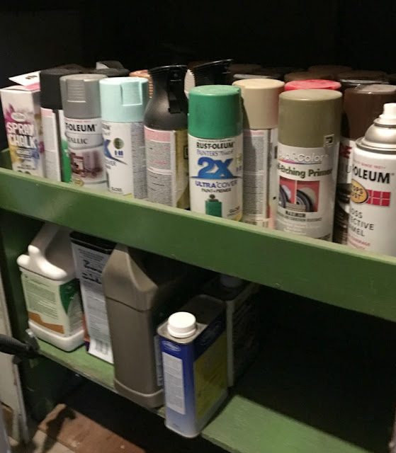 Organize your paint and related painting supplies with shelves and plumbing pipe.