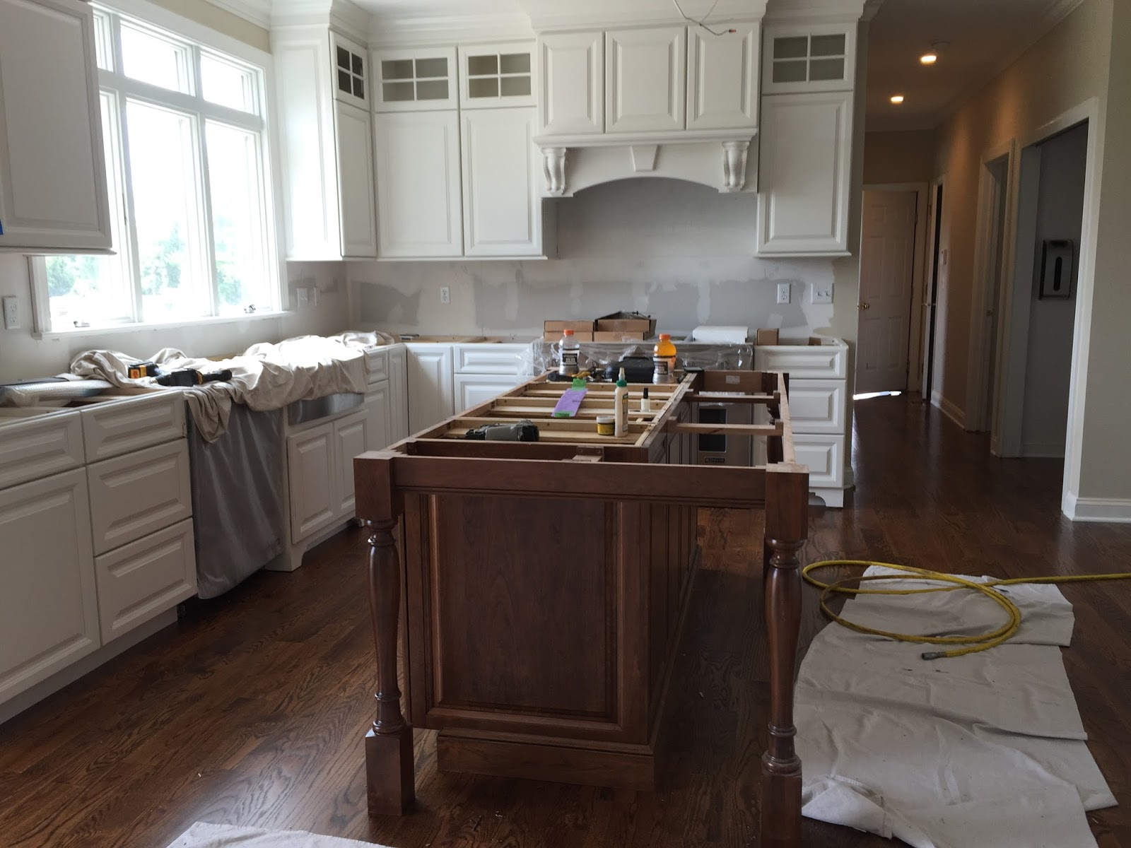 White kitchen with stained island - floors finished Minwax Provincial stain