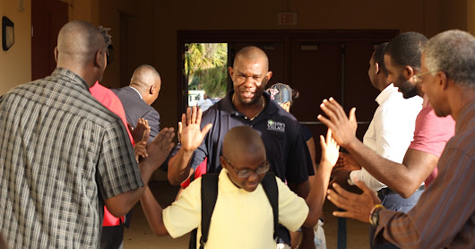 Inner City Innovator gathers Men to welcome Elementary Students to back School!