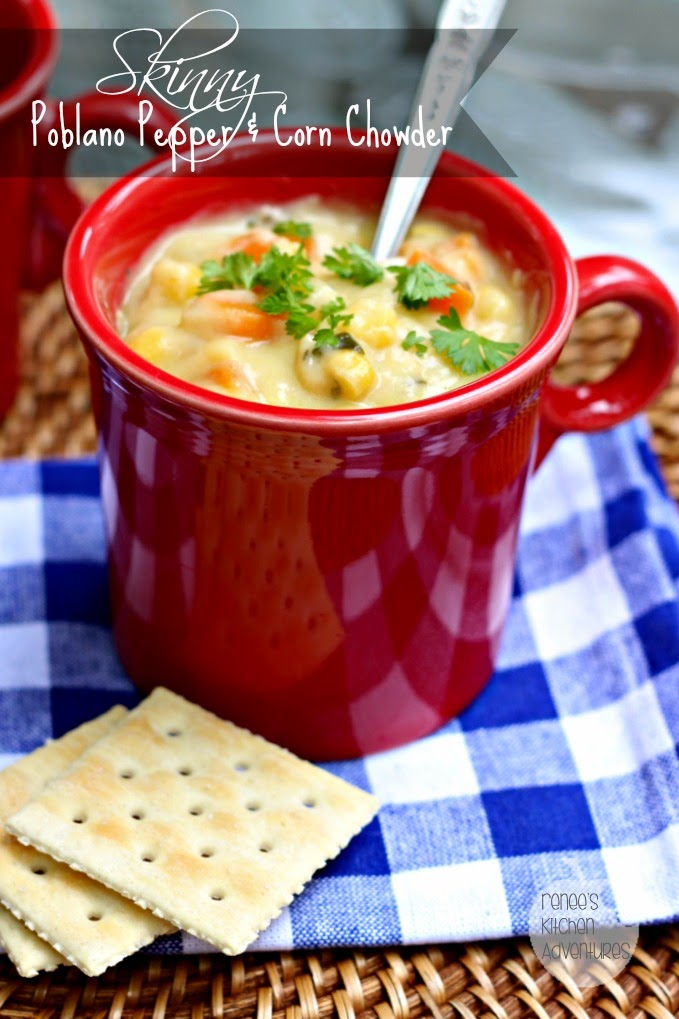 A close up of a red mug with  Skinny Corn Chowder with Poblano Peppers by Renee's Kitchen Adventures and a spoon ready to eat