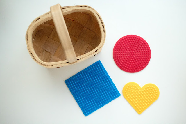 An unexpected treasure basket makes for an exciting Montessori baby toy!