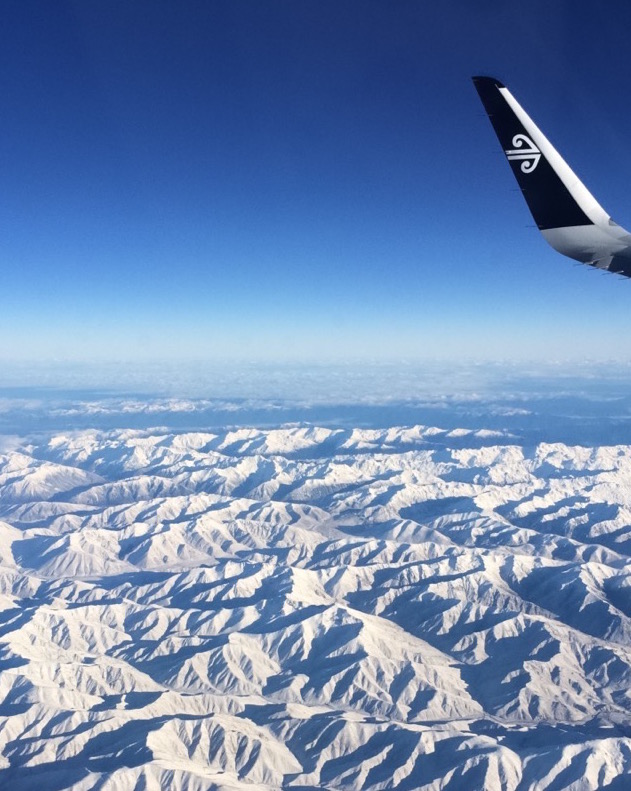 Snowy mountains flying over New Zealand