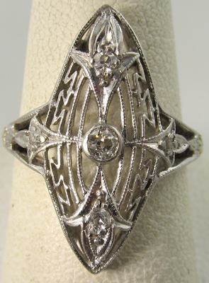 Edwardian platinum, yellow gold, and diamond shield ring.