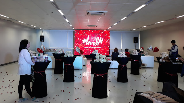 The set up spells L-O-V-E with the red theme, sweet music, flower petals, stuffed toys, balloons shaped like a giant heart!