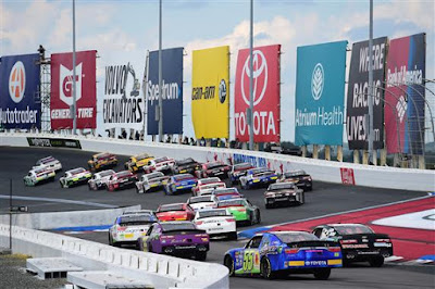 Cars race on the back stretch during the NASCAR XFINITY Series  Drive for the Cure 200 at Charlotte Motor Speedway