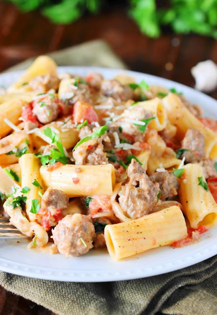 Pair this Pasta in Creamy Sausage Sauce with some warm crusty bread and a simple salad for a quick and easy complete meal.  Then get ready to dig on in to a plate of pasta deliciousness!