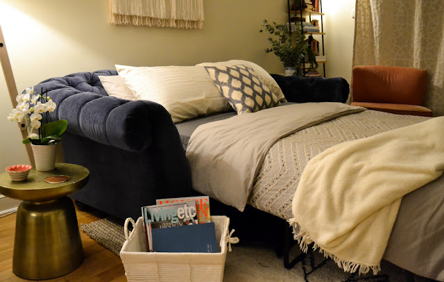 Chesterfield sofa bed at night