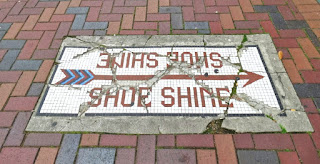 This way to the shoe shine - mosaic arrow on sidewalk