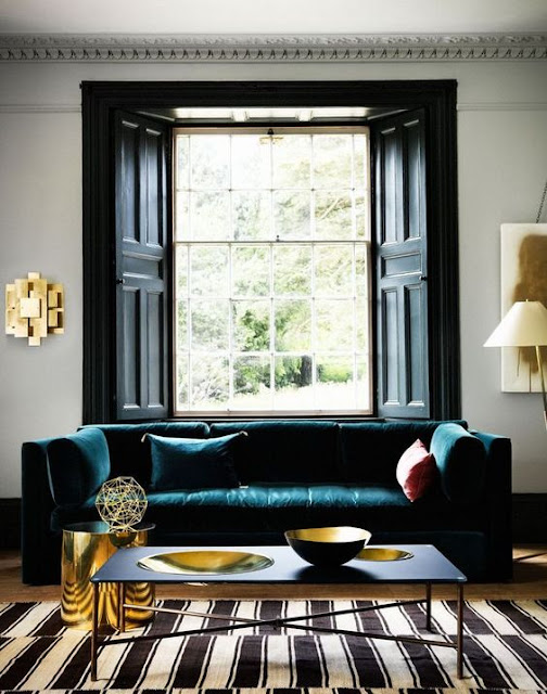 Black and White Rug and Teal Sofa Interior Design