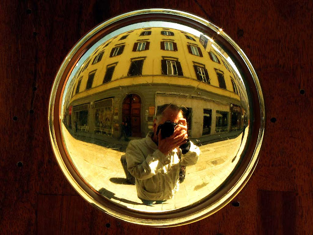 Self-portrait in a polished brass door knob, via Ricasoli, Livorno