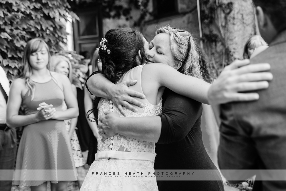 Guest congratulating bride after wedding ceremony