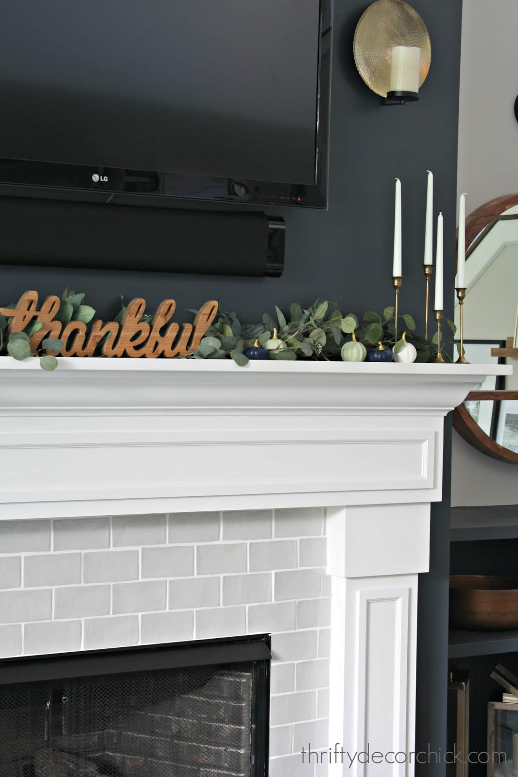 Simple fall mantel with eucalyptus and pumpkins