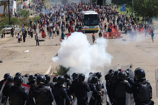 police teachers clash mexico