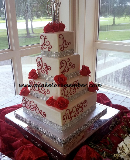 This Ercream Wedding Cake Had Red Gumpaste Roses And Silver Bling Wrap Around The Base Of Tiers Pattern Was Piped On In