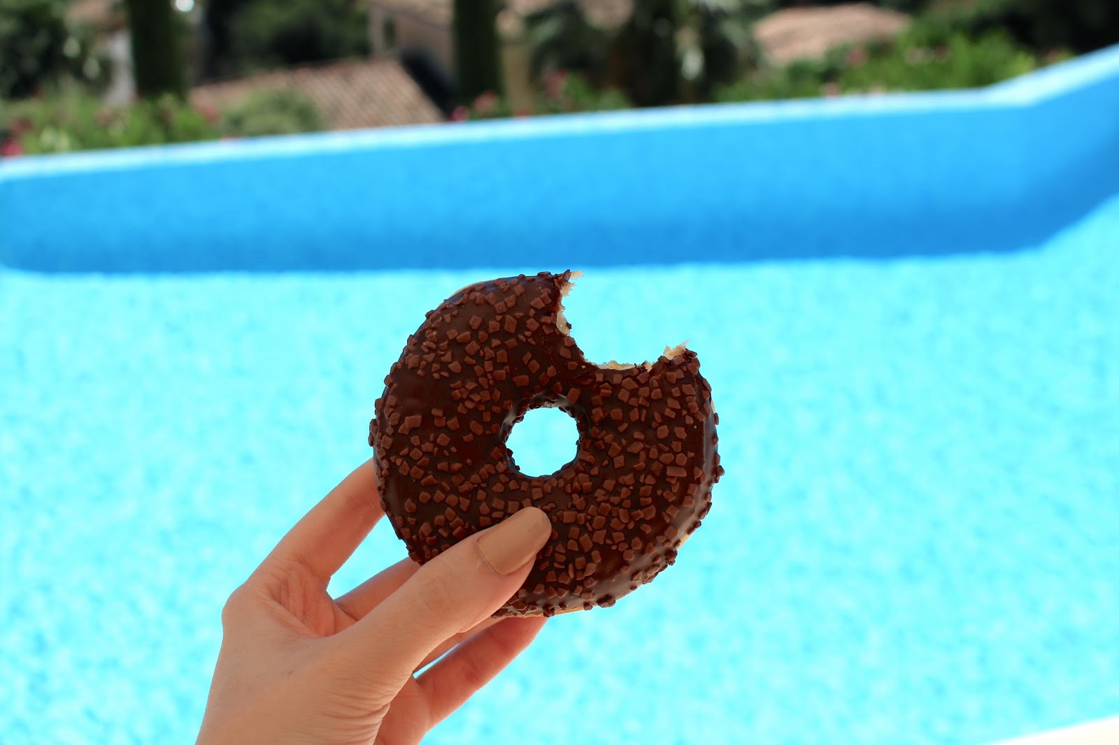 Chocolate doughnut with a bite out of it