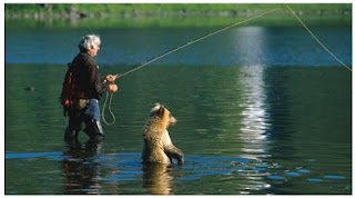 Charlie Russell and his adopted bear cub sport fishing